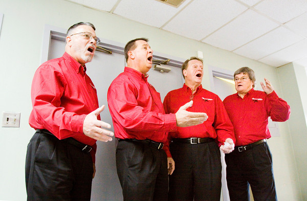 Finish Line, a barbershop quartet with the Thoroughbred Chorus out of Louisville, perform in the dining room at the Clark Arms apartments during the Clark County Housing Authority's holiday party for the residents of the facility in Jeffersonville on Thursday afternoon. Staff photo by Christopher Fryer