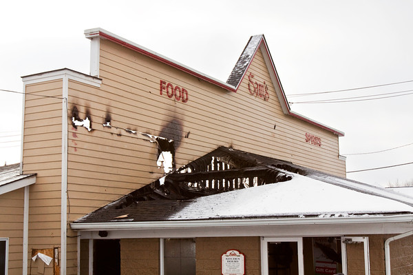 The facade of Sam's Food and Spirits sits on its location at 3800 Payne Koehler Road on Tuesday morning in New Albany after the business was heavily damaged by a fire late Monday night. Staff photo by Christopher Fryer