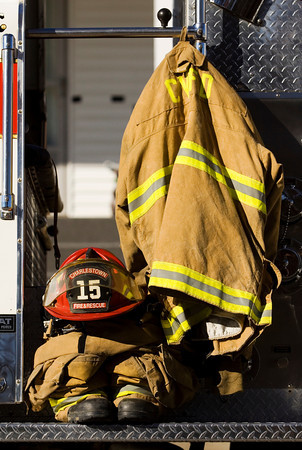 A firefighter suit sits on the side of a Charlestown Volunteer Fire Department engine in honor of Carl Glen Hall before members of the department drove his casket to the Charlestown Cemetery following a service at Grayson Funeral Home on Friday afternoon. Hall passed away on December 21 at the age of 67. He was a member of the fire department for 50 years. Staff photo by Christopher Fryer