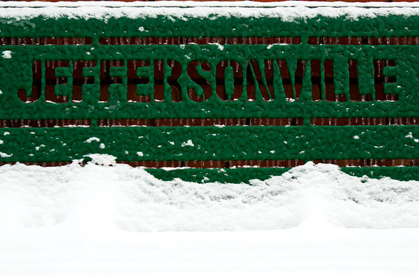Ice and snow cling to a City of Jeffersonville bench in downtown Jeffersonville on Saturday afternoon. According to the National Weather Service, more winter weather with mixed precipitation will move across the region on Sunday, and temperatures will remain cold with a high of 33 degrees. Staff photo by Christopher Fryer
