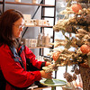 Donna Jenkins, 52, Sellersburg, looks at cake stands at Dress and Dwell in New Albany on Saturday. Jenkins was topping off everything she needed on her Christmas shopping list. Staff photo by Jerod Clapp