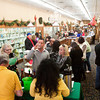 Participants move through a Jingle Walk tasting location at J.O. Endris & Son Jewelers during HolidayFest in downtown New Albany on Saturday afternoon. Staff photo by Christopher Fryer