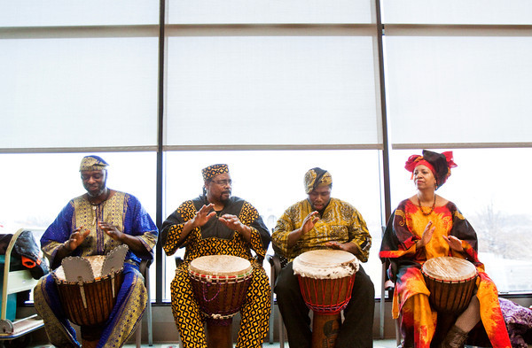 Djembe drummers play traditional West African rhythms during the 12th annual Kwanzaa Celebration at the Jeffersonville Township Public Library on Saturday afternoon. Staff photo by Christopher Fryer