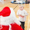 Christian McQuigg, 7, Floyds Knobs talks with Santa Claus at the Floyd County branch of the YMCA of Southern Indiana during HolidayFest in downtown New Albany on Saturday afternoon. Staff photo by Christopher Fryer