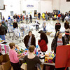 Volunteers help families pick up toys, clothing and food items at the Salvation Army's Christmas assistance program on Saturday morning in New Albany. Staff photo by Christopher Fryer