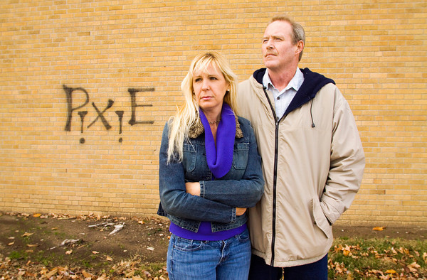 Todd Willenborg and Kelley Curan stand next to a wall that bears their daughter's nickname in downtown Jeffersonville. Their daughter, Tara Willenborg, was found dead inside her Clarksville apartment after allegedly being raped and strangled by Richard Carly Hooten Jr. in early March of this year. Staff photo by Christopher Fryer