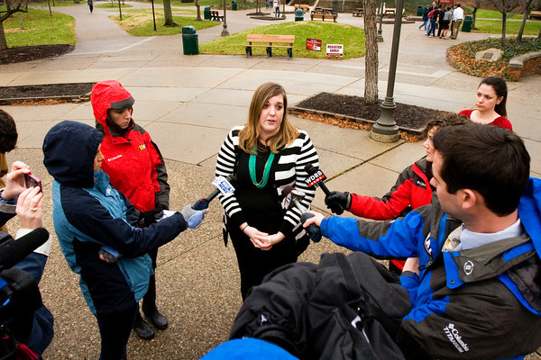 Indiana University Southeast Public Relations Specialist Erica Walsh speaks to members of the media after law enforcement officials responded to reports of an armed person on campus Thursday afternoon. Officials gave the all clear after they identified the person as a theater student with a BB gun. Staff photo by Christopher Fryer