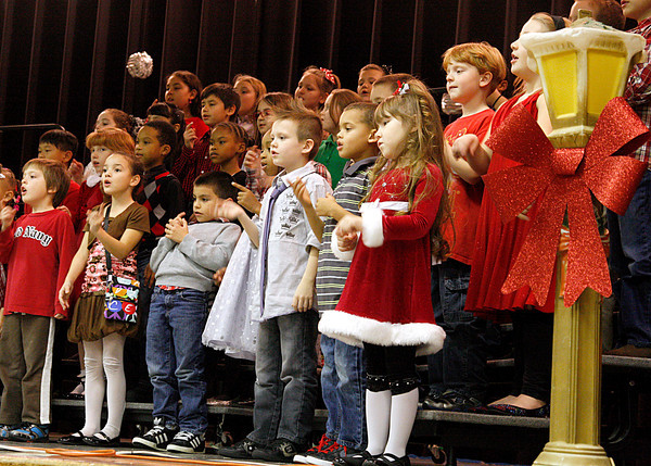 "Second-graders at W. E. Wilson Elementary School sing during partof their program, ""Holidays Around the World"" on Thursday. Students sang at the beginning, then presented to parents what holidays are celebrated worldwide. Staff photo by Jerod Clapp"