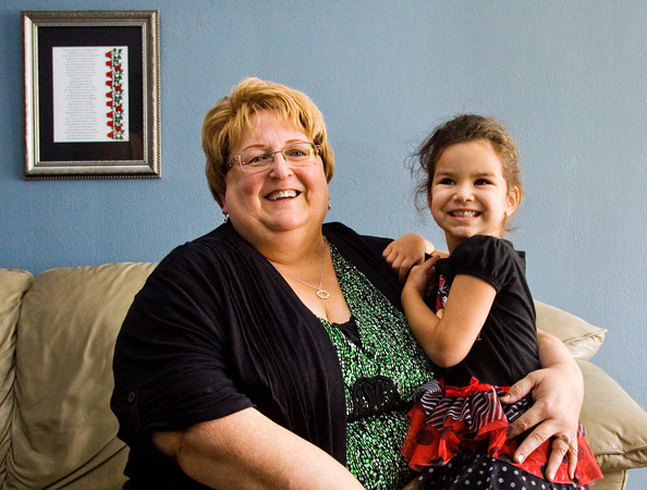Tonya McAnelly holds her granddaughter Tiana, 4, in their New Albany home. Staff photo by Christopher Fryer