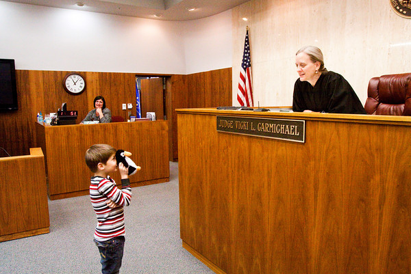 Judge Vicki Carmichael conducts an adoption ceremony with Cameron Hughes, 7, Jeffersonville, for his stuffed animal Peanut Butter during her annual Adopt-A-Doll event in Circuit Courtroom No. 4 at the Clark County Government Building in Jeffersonville on Saturday morning. Staff photo by Christopher Fryer
