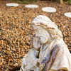 A statue of Jesus Christ sits in the memorial garden for Tara Willenborg in front of St. Luke's United Church of Christ in Jeffersonville. Willenborg, who was a member of the church, was found dead inside her Clarksville apartment after allegedly being raped and strangled by Richard Carly Hooten Jr. in early March of this year. Staff photo by Christopher Fryer