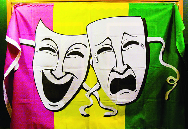 A drama masks banner hangs in the lobby of the Clarksville Little Theatre. Staff photo by Christopher Fryer