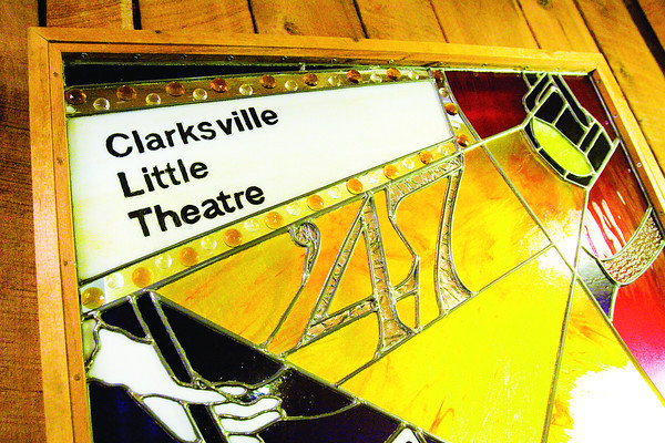 A stained-glass piece hangs in the lobby of the Clarksville Little Theater. Staff photo by Christopher Fryer