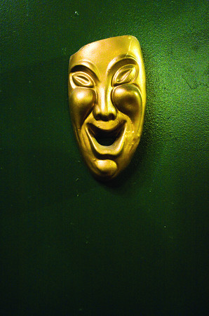 A drama mask art piece hangs in the lobby of the Clarksville Little Theatre. Staff photo by Christopher Fryer