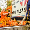 Amy Cummins, New Albany, helps decorate the Harvest Homecoming Committee's parade float in New Albany on Tuesday afternoon. The Harvest Homecoming Parade will begin at noon on Saturday at New Albany High School and end at the intersection of Bank and Elm streets near the Carnegie Center. Staff photo by Christopher Fryer
