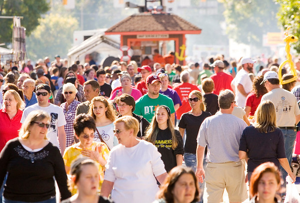 Attendees move between booths and vendors during Harvest Homecoming in downtown New Albany on Thursday afternoon. Staff photo by Christopher Fryer