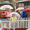 Scribner family descendants wave to the crowd from the Grand Marshall Float during the Harvest Homecoming Parade in New Albany on Saturday afternoon. Staff photo by Christopher Fryer