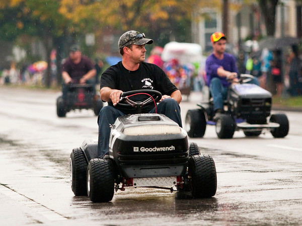 Members of the Southern Indiana Lawn Mower Racing Association ride down Spring Street in the Harvest Homecoming Parade in New Albany on Saturday afternoon. Staff photo by Christopher Fryer