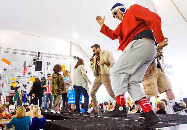 Thrift shop skit performers dance on stage during the We Built This City Harvest Homecoming Luncheon along the New Albany riverfront on Friday afternoon. Staff photo by Christopher Fryer