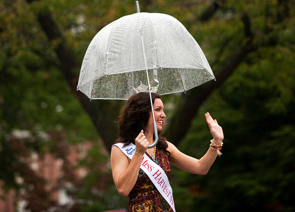 Miss Harvest Homecoming Paige Conrad waves to the crowd as she walks down Spring Street during the Harvest Homecoming Parade in New Albany on Saturday afternoon. Staff photo by Christopher Fryer