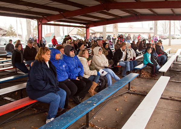 Community members listen to speakers during a remembrance ceremony for those affected by the March 2 tornadoes in New Pekin on Saturday afternoon. Staff photo by Christopher Fryer