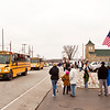 West Clark Community Schools buses move through Henryville on Saturday during a parade to commemorate the year anniversary of the March 2 tornadoes. Staff photo by Christopher Fryer