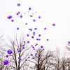 Balloons are released into the sky during a community remembrance ceremony for those affected by the March 2 tornadoes in New Pekin on Saturday afternoon. Five white balloons were released in honor of the Babcock family that died when the storm hit a year ago. Staff photo by Christopher Fryer