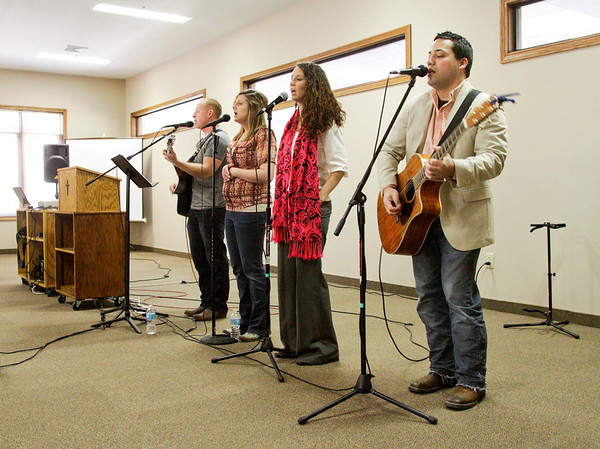 The Mt. Moriah Praise Team leads the congregation in song during their morning service at Country Lake Christian Retreat in Underwood on Sunday. Their church along Henryville-Otisco Road was destroyed last year by the March 2 tornadoes, and they held services in a tent until this past December when they started holding their services at the retreat. Staff photo by Christopher Fryer