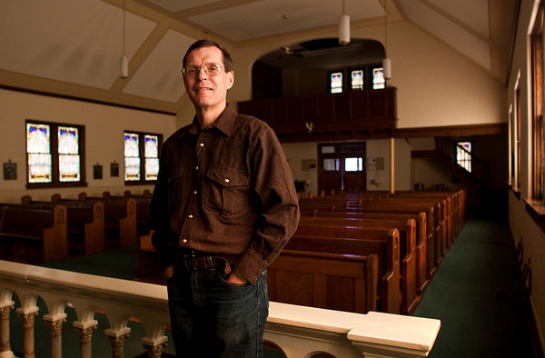 Rev. Steve Schaftlein, of St. Francis Xavier Catholic Church, stands in their sanctuary on Thursday afternoon in Henryville. The church was damaged by the March 2 tornadoes last year, but survived the storm and became a staging point for much of the aid provided during the recovery effort. Staff photo by Christopher Fryer