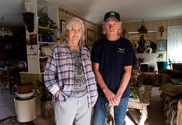 Donna Kaelin and Will Callahan stand in the living room of their home in New Pekin on Wednesday afternoon. As the storm that spawned two tornadoes approached the area last March, the couple drove to Daisy Hill to Kaelin's daughter's home to check on family and seek shelter in their basement. The Daisy Hill home took a direct hit and Callahan suffered injuries to his back and right leg. Staff photo by Christopher Fryer