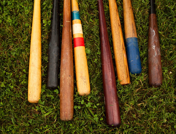 Baseball bats sit on the ground next to the Cincinnati Buckeyes' bench during their old fashioned baseball game against the Huntington Champion Hill Toppers at Binford Park in New Albany on Saturday. Staff photo by Christopher Fryer
