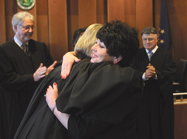 Rexann Farris receives a hug from Superior Court No. 1 Judge Susan L. Orth after Farris was sworn in Monday afternoon as the Chief Probation Officer of the newly unified Floyd County Probation Office.  Staff photo by C.E. Branham