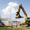 Joe Bierman, of Floyds Knobs, uses an excavator to demolish a structure on the lot located at the corner of Elm Street and First Street in New Albany on Wednesday morning. Staff photo by Christopher Fryer