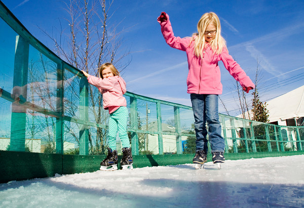 From left, Sarah Ward, 5, and her sister Phoebe, 7, both of Jeffersonville, attempt to keep their balance as they skate around the Jeffersonville Ice Rink, located along the 200 block of Spring Street, on Friday afternoon. Yesterday was the opening day for the rink, which will be in operation through the end of January. Staff photo by Christopher Fryer