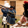 Mark Kreps, of Muncie, takes a photograph while the Harrison County Yellow Jackets, a War of 1812 reenactment group, perform a 21-gun salute to honor the victims of the Pigeon Roost Massacre during a living history, bicentennial commemoration of the event at the historic John Work House at Tunnel Mill near Charlestown on Saturday afternoon. Staff photo by Christopher Fryer