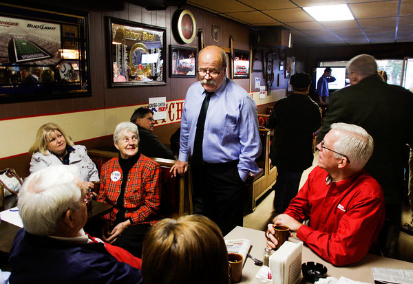 Democratic gubernatorial candidate John Gregg talks with a few of his supporters in the Hitching Post Tavern during a stop on his statewide bus tour in downtown New Albany on Friday morning. Friday was the seventh day of his eight day bus tour through 72 Indiana cities that ends today in Indianapolis. Staff photo by Christopher Fryer