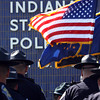 The Indiana State Police Sellersburg District honor guard retires colors at the conclusion of a memorial service Wednesday. Staff photo by C.E. Branham