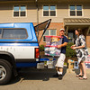Jeff and Jennifer Pace, Indianapolis, unpack their truck while helping their daughter, Haley, move into her apartment in the Meadow Lodge at Indiana University Southeast in New Albany on Thursday morning. Haley is one of 265 new students that are signed up to live in on-campus housing. Staff photo by Christopher Fryer