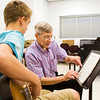 """Musician Jamey Aebersold, of New Albany, helps guitarist Corin Duey, 14, of Philadelphia, while he plays """"Quiet Nights of Quiet Stars"""" in a jazz combo during Aebersold's Summer Jazz Workshop at the University of Louisville School of Music earlier this month. Staff photo by Christopher Fryer"""