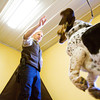 "Dog trainer Matthew Duffy, left, works with the basset hound Intermezzo, or Mari for short, during a session at Duffy's Dog Training Center in Jeffersonville. Duffy recently wrote ""Dog Training and Eight Faces of Aggressive Behavior: A Master's Solution to Barkers, Growlers and Biters"" which is scheduled to be released in early December. Staff photo by Christopher Fryer"