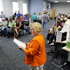 WorkOne Region 10 Operations Manager Jackie James looks over a list of names while calling people back to apply for positions with the new Amazon fulfillment center in Jeffersonville during a job fair at WorkOne, 2125 State St., in New Albany on Thursday afternoon. Staff photo by Christopher Fryer