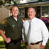 Mac Spainhour, right, of Clarksville, and his son Bo, of Borden, stand in front of Mac's home on Thursday evening. Mac is a retired Indiana Department of Natural Resources conservation officer and Bo currently works for the department. Bo took his father's place in Clark County when he retired. Staff photo by Christopher Fryer
