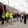 Passengers exit the Norfolk Southern Operation Lifesaver Whistle-Stop Train in Huntingburg after a train tour to promote highway-rail and pedestrian safety on Friday. Staff photo by Christopher Fryer