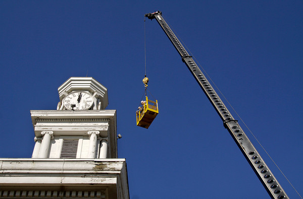 Structural engineer Carl Slesser and architect Larry Timperman take photographs of the clock tower and front facade of the Second Baptist Church during a structural analysis of the historic building in downtown New Albany on Wednesday morning. Staff photo by Christopher Fryer