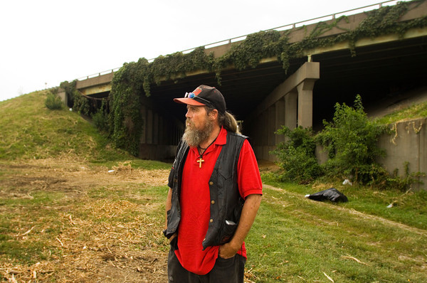 Roy White stands next to an overpass along Interstate 65 in Jeffersonville on Tuesday evening. White has been homeless for five years, and he and several other members of the homeless community are being affected by the I-65 bridge work. Staff photo by Christopher Fryer