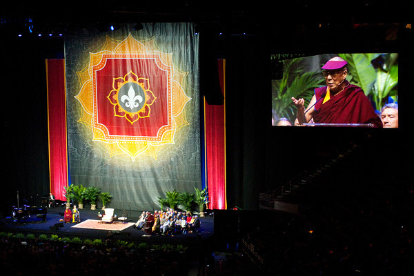 The Dalai Lama speaks during a public talk that focused on compassion and its importance in today's world at the KFC Yum! Center in Louisville on Sunday afternoon. Staff photo by Christopher Fryer
