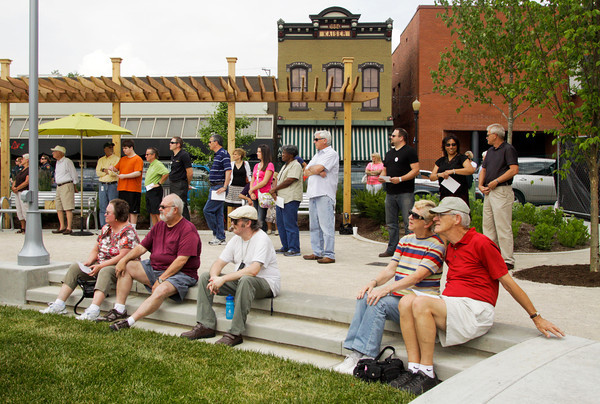 Spectators listen to speakers during the official opening of the Bicentennial Park at the corner of Spring and Pearl streets in downtown New Albany on Friday evening. Staff photo by Christopher Fryer