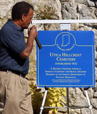 Curtis Wells, a member of the Utica Preservation Association, unveiled a sign recognizing Hillcrest Cemetery in Utica as a historic cemetery in Indiana's Cemetery and Burial Grounds Registry. Staff photo by C.E. Branham