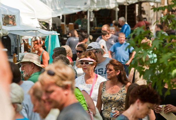 Attendants browse through different booths at Art in Speed Park in Sellersburg on Saturday afternoon. Staff photo by Christopher Fryer