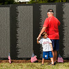 U.S. Veteran Raymond Leach, of Jeffersonville, and his grandson, John Mark Cox, 4, visit the American Veterans Traveling Tribute Vietnam Wall next to the Clarksville Municipal Center along Veterans Parkway on Thursday afternoon. Staff photo by Christopher Fryer